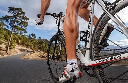 Close-up of leg muscles while cycling.