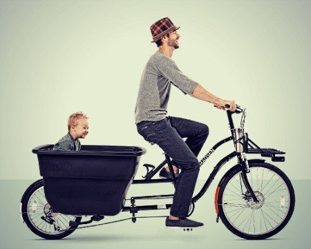 Dad & boy riding a bike.