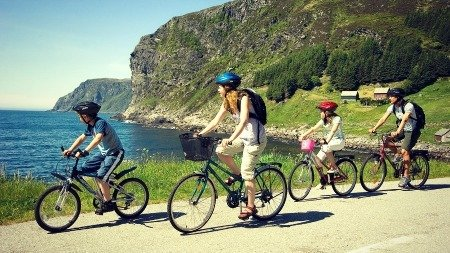 Happy family cycling
