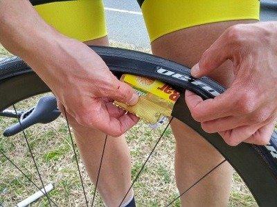 Emergency fix of a flat bike tire.
