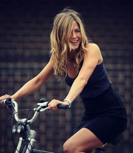 Jennifer Aniston riding a bike