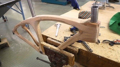 Putting the wooden bike together.