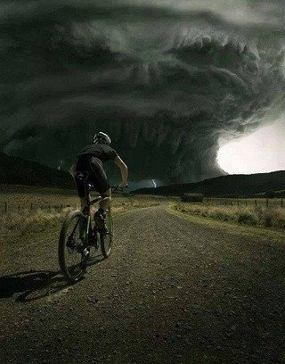 Man cycling in a storm.