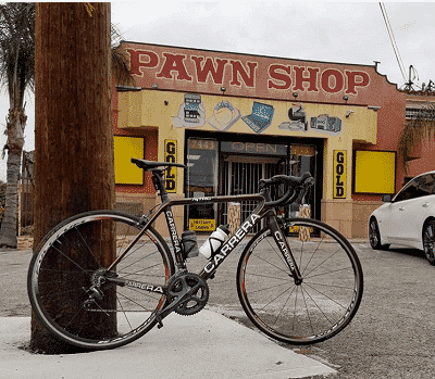 Pawn shop with a bike in front.