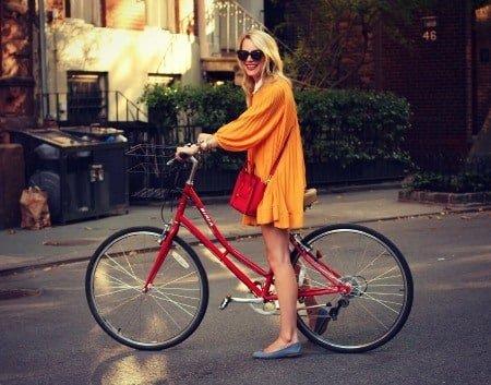 Woman in orange dress.