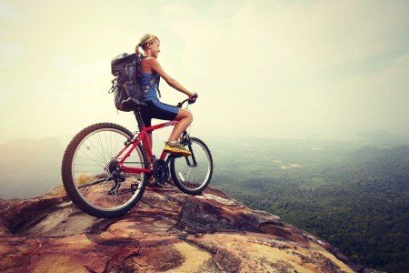 Woman and mountain bike.
