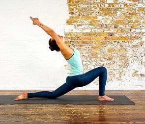 Woman doing yoga low lunge.