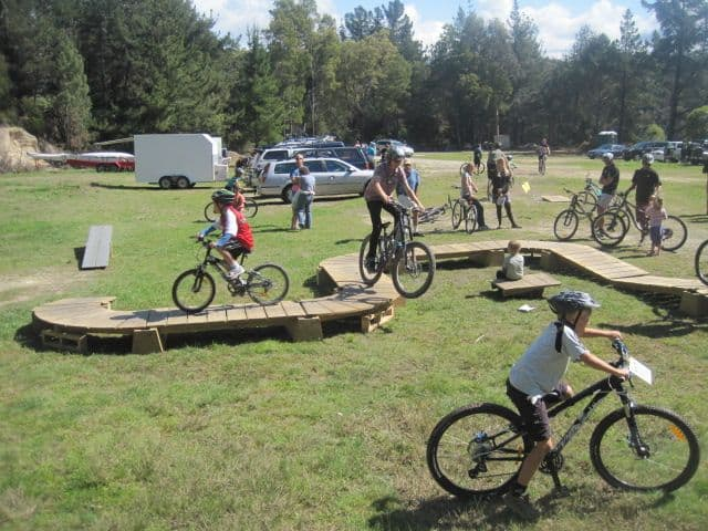 Kids Competing On Bike Course