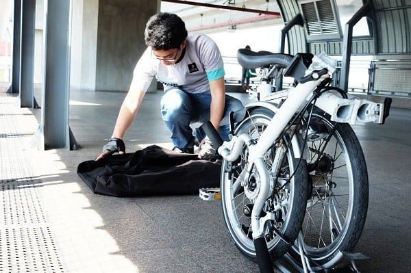 Man Folding a Bike In The Bag