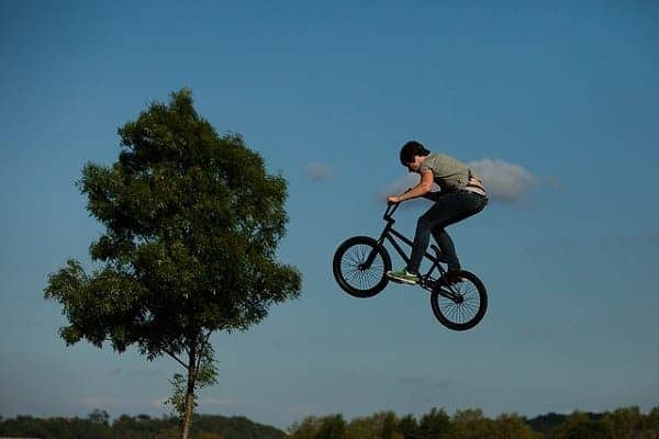 Man flying with bike