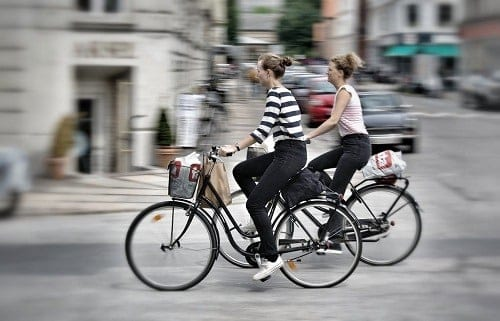 Girls riding bikes in Copenhagen