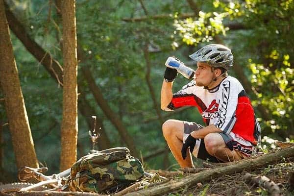 Cyclist drinking from the bottle