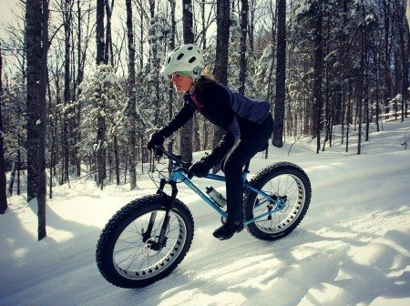 Woman riding fat bike.