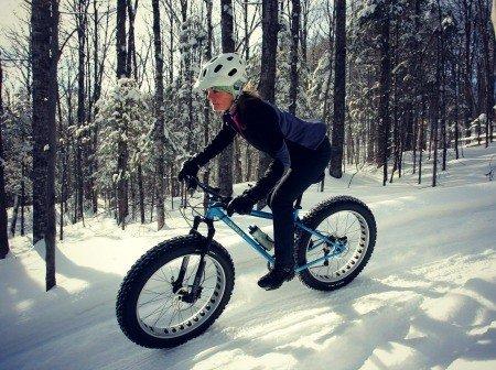 Woman riding fat bike.