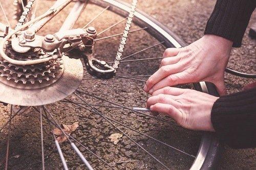 Man fixing flat bike tire