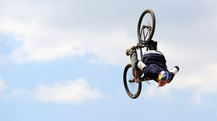Man doing acrobatics with his bike