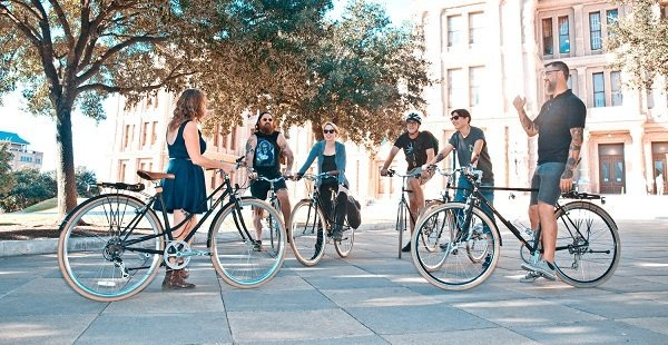 Group of people on their bikes in the park