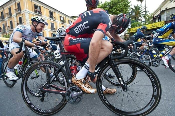 Man wearing Nike custom cycling shoes on a race