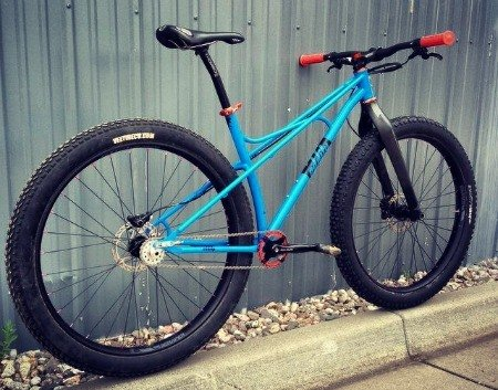 Rigid blue mountain bike.