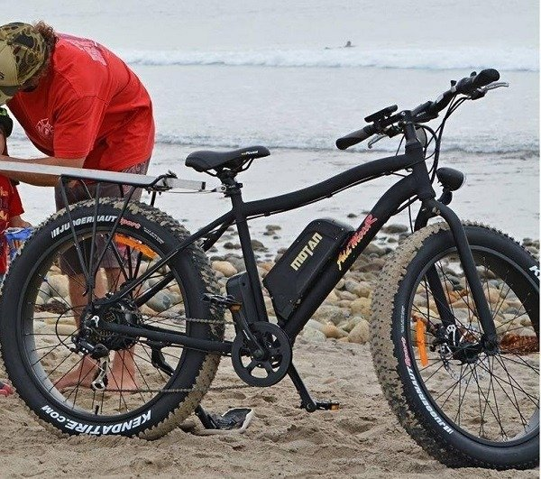 Riding Electric Bike on The Beach
