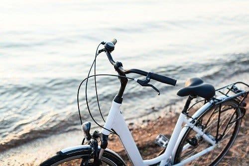 White comfort bike on a beach