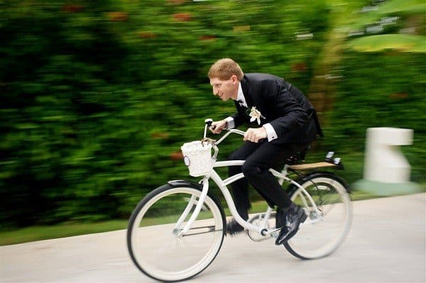 Groom riding a cruiser bicycle