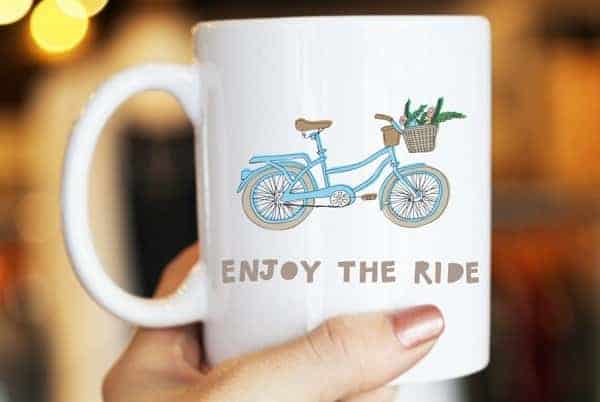 Holding a cup portraying a cruiser bike