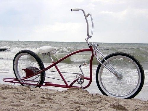 Red Chopper Cruiser Bike On A Beach