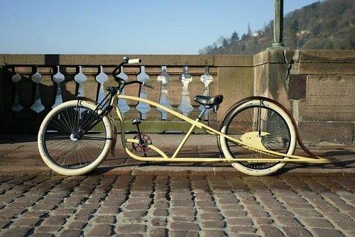 Yellowish stretch cruiser bike on a driveway