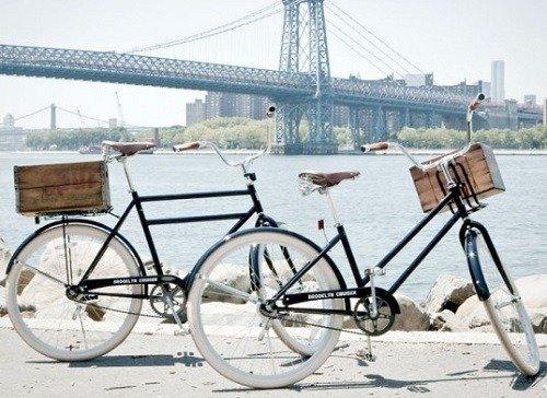 Two cruiser bikes on a boardwalk