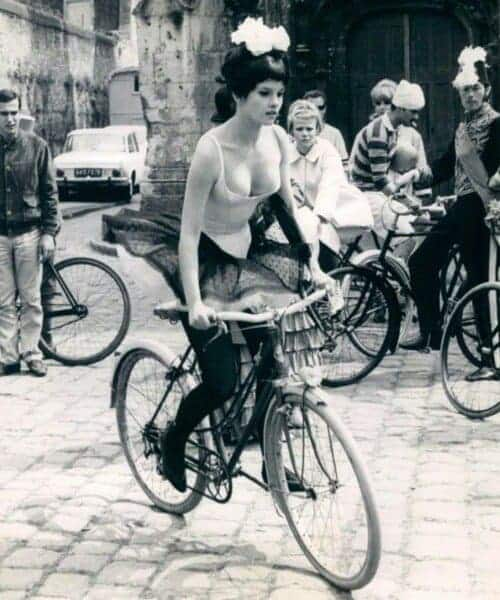 Woman riding vintage bike with other cyclist in the background