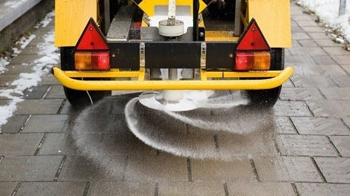 Putting salt on the roads.
