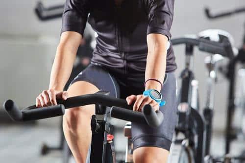 riding an exercise bike