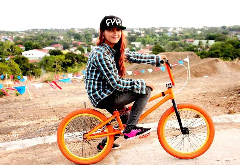 girl riding a bmx bike