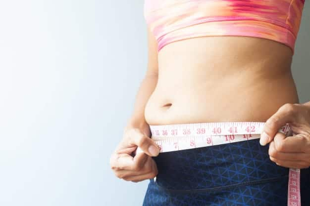 slimming-woman-with-belly-fat-sporty-woman-measuring-belly-fat-close-up_1428-2320